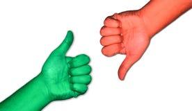 Положительный ответ и недостаток большого пальца руки Стоковые Изображения
