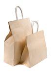 положите бумажную белизну в мешки покупкы 2 стоковые изображения rf