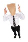 положите головку в мешки бизнесмена над бумагой Стоковая Фотография RF