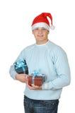 положите детенышей в коробку настоящего момента s santa человека удерживания шлема Стоковые Изображения RF