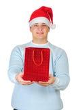 положите детенышей в мешки настоящего момента s santa человека удерживания шлема Стоковое Изображение