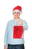 положите детенышей в мешки настоящего момента s santa человека удерживания шлема Стоковые Фото