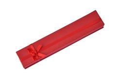 положите длинний красный цвет в коробку Стоковые Фотографии RF