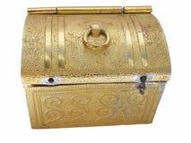 положите золотистое в коробку Стоковое Изображение