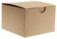 положите коричневую закрынную классику в коробку стоковые фото