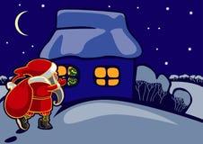 положите подарки в мешки santa claus Стоковое фото RF