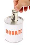 положите пожертвование в коробку доллара стоковые фотографии rf