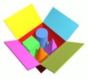 положите покрашенные геометрические предметы в коробку Стоковое фото RF