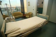 положите стационар в постель спальни Стоковые Изображения RF