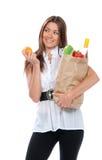 положите счастливых детенышей в мешки женщины покупкы удерживания Стоковое фото RF