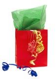 положите тесемки в мешки подарка красные глянцеватые Стоковые Изображения RF