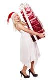 положите шлем в коробку девушки подарка рождества держа красный santa Стоковая Фотография RF