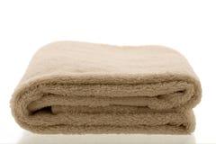 полотенце сложенное коричневым цветом светлое Стоковые Фотографии RF