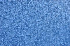 полотенце terry плюша ткани ванны предпосылки голубое Стоковое Изображение