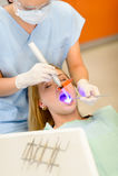 польза женского светильника дантиста терпеливейшая Стоковое Изображение RF