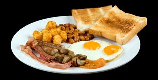 Польностью английский завтрак изолированный на черной предпосылке стоковое изображение