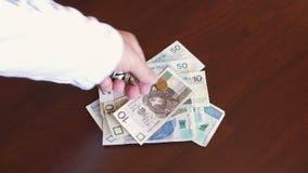 Польский злотый - банкноты и монетки денег zl видеоматериал