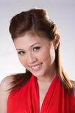 помадка усмешки платья счастливая красная Стоковые Фото