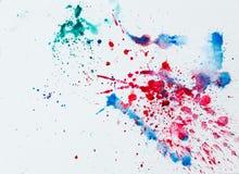 Помарки акварели красочные над белой бумагой Стоковые Изображения RF