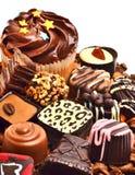 Помадки hocolate ¡ Ð, булочки и зерна кофе Стоковая Фотография RF