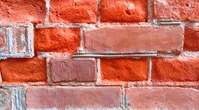 Померанцовая кирпичная стена кирпичи кирпича много старая стена текстуры стоковые фото