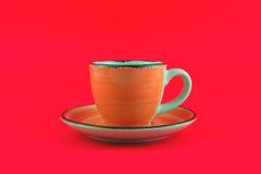 Померанцовая чашка Стоковые Изображения