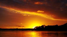 Померанцовое пламя - заход солнца. Стоковое Изображение