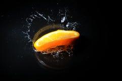 померанцовый выплеск Стоковая Фотография