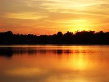 померанцовый заход солнца Стоковые Фото
