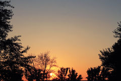 померанцовый заход солнца Стоковые Изображения