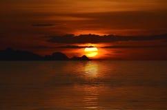 померанцовый заход солнца Стоковые Фотографии RF