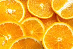 Померанцовый плодоовощ Оранжевые куски, половинный апельсин, весь апельсин, оранжевая предпосылка Стоковые Фотографии RF