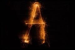 Пометьте буквами a сделал бенгальских огней на черноте Стоковые Фотографии RF