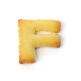 Пометьте буквами f сделанный из изолированного печенья шутихи на белой предпосылке Стоковое Изображение