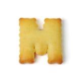 Пометьте буквами m сделанный из изолированного печенья шутихи на белой предпосылке Стоковая Фотография RF