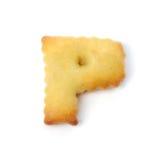 Пометьте буквами p сделанный из изолированного печенья шутихи на белой предпосылке Стоковые Фото
