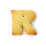 Пометьте буквами r сделанный из изолированного печенья шутихи на белой предпосылке Стоковое Фото