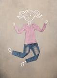 Помещенные одежды в действии с чертежом женщины Стоковая Фотография RF