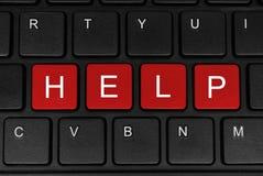 Помощь слова сделанная из 4 красных кнопок Стоковая Фотография