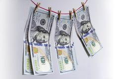 Помытые доллары, фото крупного плана 100 банкнот доллара дальше Стоковая Фотография