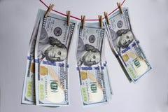 Помытые доллары, фото крупного плана 100 банкнот доллара на белой предпосылке Съемка макроса Стоковое фото RF