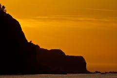 поплавайте вдоль побережья заход солнца океана Стоковое Изображение