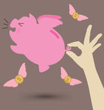 Попытка руки для того чтобы уловить розовую копилку Стоковое Фото