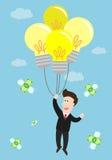 Поплавок бизнесмена в воздухе воздушным шаром электрической лампочки идеи Стоковые Фото
