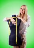Портной женщины работая на платье Стоковые Изображения