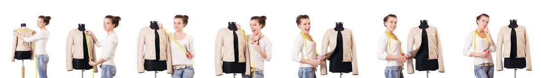 Портной женщины работая на платье Стоковые Фото