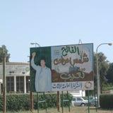 Портреты Gheddafi в улице стоковое фото