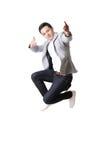 Портрет азиатского человека в изолированной предпосылке с знаком жеста Стоковое Изображение RF