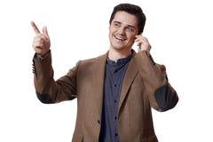 Портрет бизнесмена используя мобильный телефон на белой предпосылке Стоковая Фотография