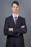 Портрет бизнесмена при пересеченные оружия Стоковые Фотографии RF